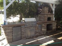 BBQ & Pizza oven w/ concrete counter top